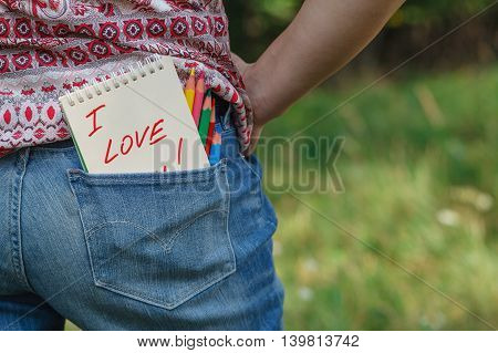 jeans pocket with a love message in garden