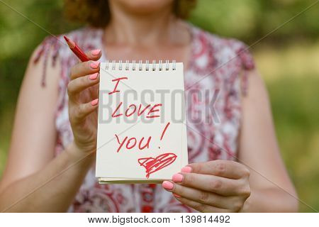 I love you message on paper in women hands