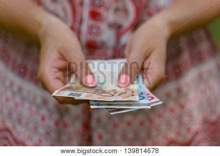 Woman Holding Euro Bill In Her Hands