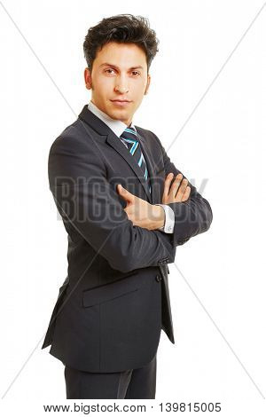 Side view of successful business man with his arms crossed