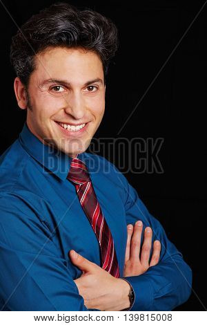 Head shot of happy business man with his arms crossed