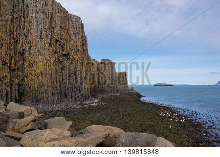 Basalt columnar rock formation Stykkisholmur in Iceland