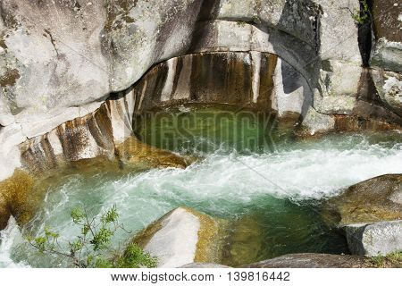Attractive nature scenery and magical efect of erosion of a mountain stream in the valley Jerte.