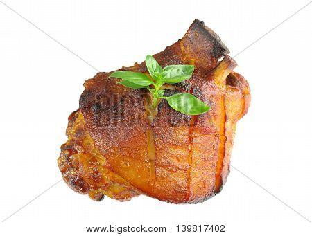 appetizing baked knuckles of pork on white background
