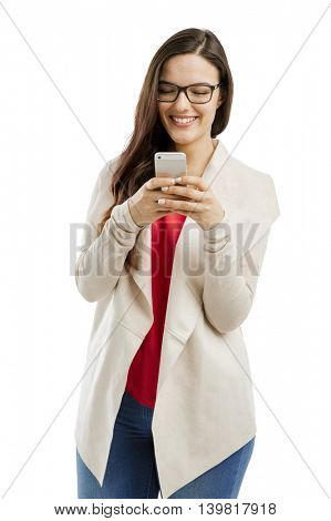Beautiful woman sending a text message, isolated over white background