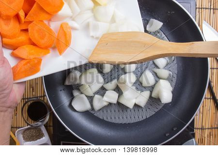 Chef putting vegetable to the pan for cooking Japanes pork curry / cooking Japanese pork curry concept