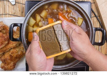 Chef prepared putting curry pasted for cooking / cooking Japanese pork curry paste concept