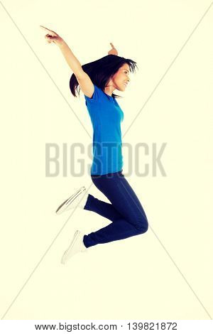 Young happy woman jumping in the air