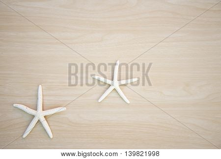 Two star fish on wooden background, Thailand