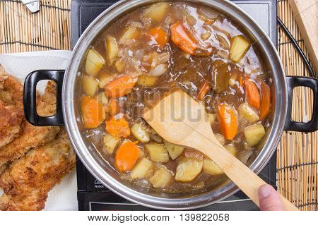 Japanese pork curry in the pot / cooking Japanese pork curry paste concept