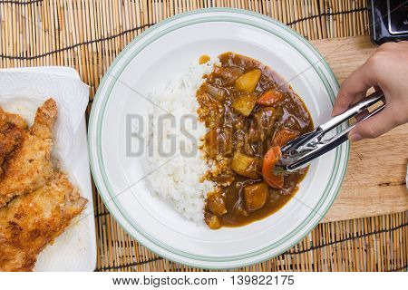 Chef decorated Japanese pork curry with steam rice / cooking Japanese pork curry paste concept