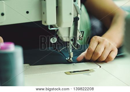 Women's hands behind her sewing. Tailoring Process.