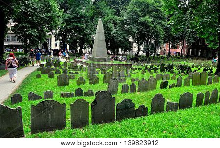 Boston Massachusetts - July 13 2013: Rows of 18th century tombstones in the historic Grannary Burial Ground on Tremont Street *