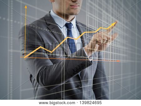 Young businessman with chart diagrams