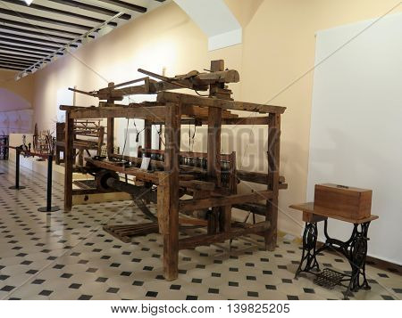 Jaen Spain June 3 2016: Old wooden loom on display in Museum in Jaen Andalusia