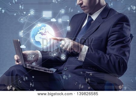 Young businessman in global computing concept