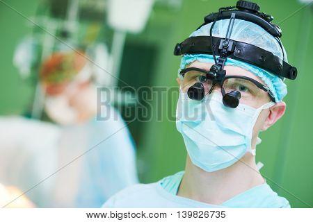 male cardiac surgeon with cardiosurgery equipment
