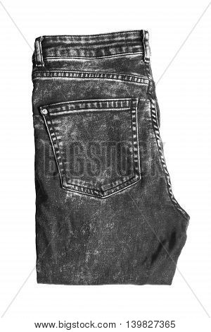 Black folded jeans isolated on white background