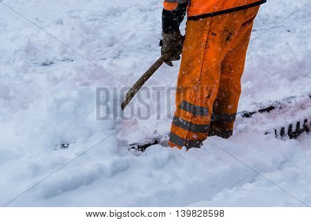 Workers sweep snow from road in winter Cleaning road from snow storm