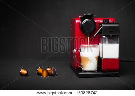 Cappuccino and espresso coffee machine on black background