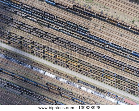 Depot With Many Railways At Day In City At Sunny Day. View From Above.