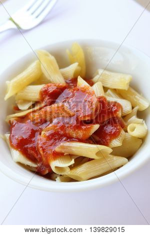 A plate of pasta with tomato sauce