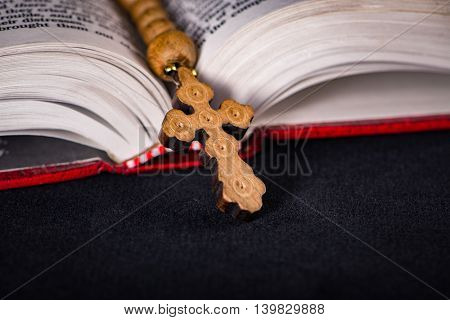 Bible and cross in religious concept