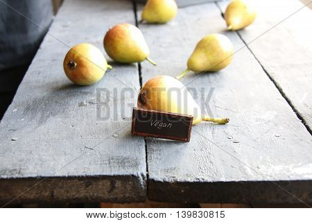Juicy flavorful pears on a wooden table - Vegan food concept