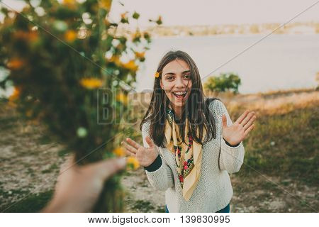 Surprise for your girlfriend. Giving flowers gift. Excited teen girl.