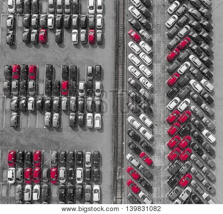 Aerial View Lot Of Vehicles On Parking For New Car. Black And White Selective Red Colour.