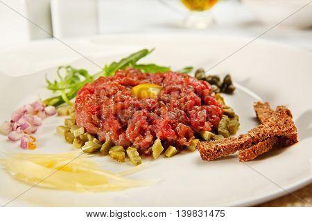 Tasty steak tartar on white plate