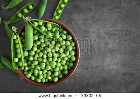 Fresh green peas in bowl, closeup