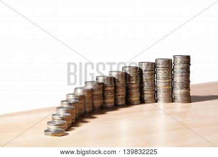 columns of coins on the table as a chart of growth closeup