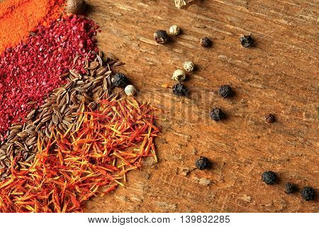 Different spices on wooden background