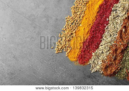 Different spices on gray background