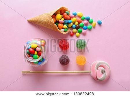 Dessert in ice cream cone on pink background