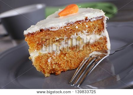 Piece of carrot cake on plate, closeup