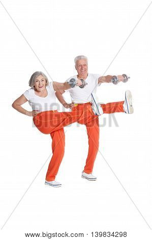 senior Couple Exercising with dumbbells On White Background