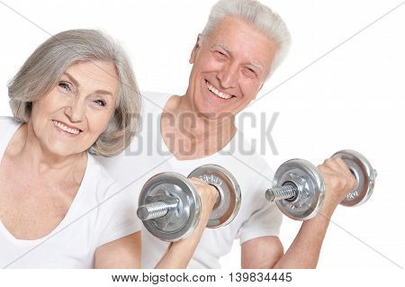 Portrait of Senior Couple Exercising On White Background