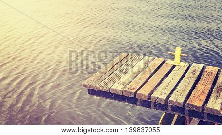 Vintage Toned Old Wooden Pier At Sunset