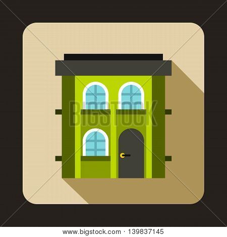 Green two storey house icon in flat style on a beige background