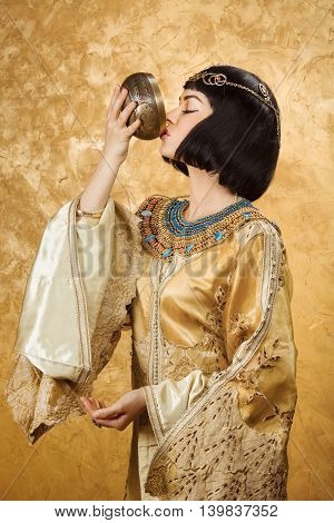 Fashion Stylish Beauty Portrait Holding and Drinking Cup. Beautiful Girl's Face Close-up.