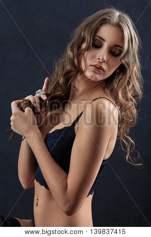 sensual aroused young woman on black background