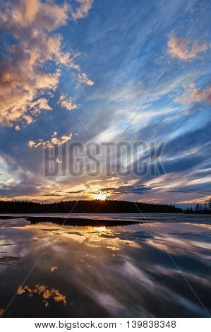 Sunset on the lake. Spring Karelia. Elm lake.