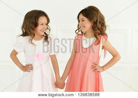 Portrait of a cute little girls posing