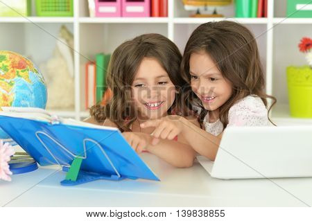 Portrait of a cute girls on lesson
