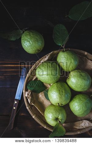 Green Guavas on the old wood, fruit from VietNam