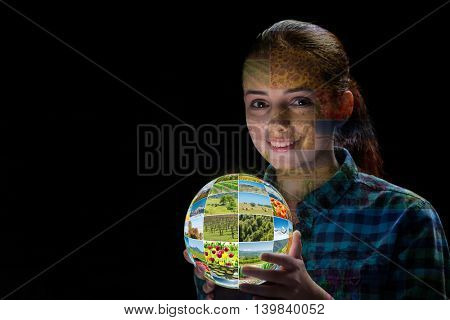 Young woman holding earth with nature photos