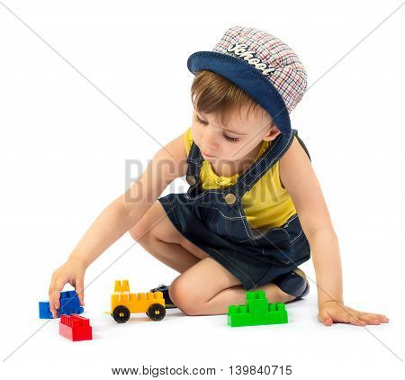 Cute little girl playing with block toys isolated on white background