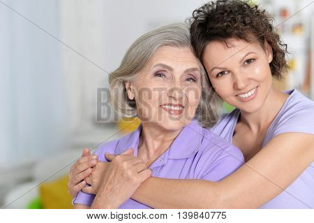 Portrait of Senior woman with daughter at home